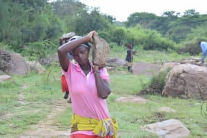 The Water Project: Kiteta Community -  Woman Carrying A Rock
