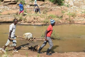 The Water Project: Kiteta Community A -  Carrying Heavy Stone