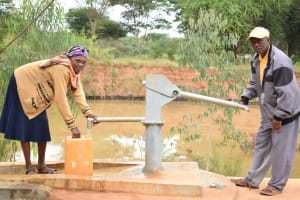 The Water Project: Kiteta Community A -  Fetching Water A The New Well