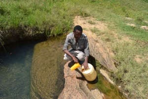 The Water Project: Mathanguni Community A -  Fetching Water At The Open Source