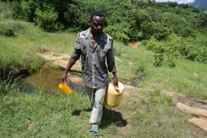 The Water Project: Mathanguni Community A -  Man Carrying Water