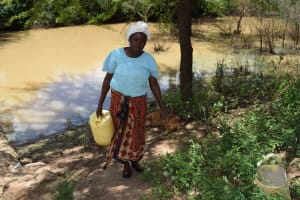 The Water Project: Mathanguni Community A -  Woman Carrying Water