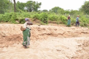The Water Project: Thona Community A -  Carrying Rocks For Project Construction
