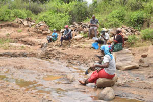 The Water Project: Thona Community A -  Self Help Group Members At The River