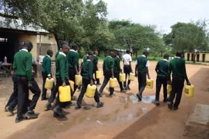 The Water Project: Kikumini Boys Secondary School -  Students Carrying Water