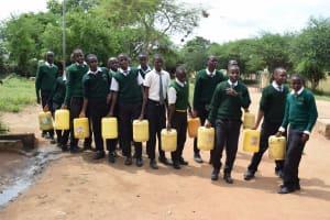 The Water Project: Kikumini Boys Secondary School -  Students Fetching Water