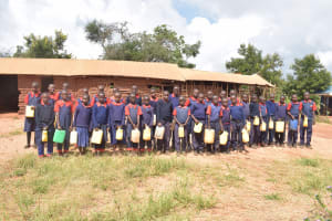 The Water Project: Ithingili Primary School -  Students Holding Water Containers