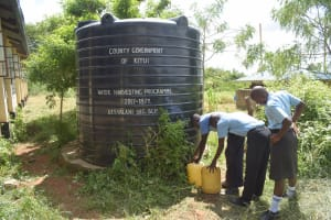 The Water Project: Kasyalani Mixed Day Secondary School -  Line At Small Rainwater Tank