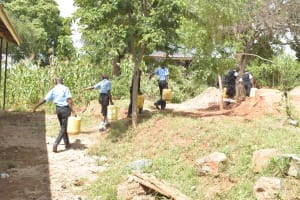The Water Project: Kasyalani Mixed Day Secondary School -  Students Carrying Water