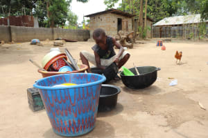 The Water Project: Rosint Community, #24 Poultry St -  Small Boy Cleaning Up Dishes