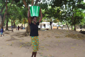 The Water Project: Rosint Community, #24 Poultry St -  Small Girl Carrying Water