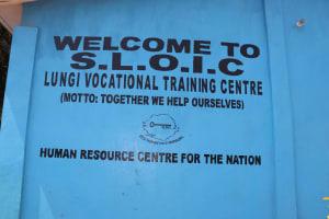 The Water Project: Kaffu Bullom, Kasongha OIC Vocational School -  School Sign