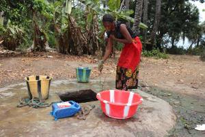 The Water Project: Lokomasama, Matong Village -  Woman Collecting Water At Alternate Water Source