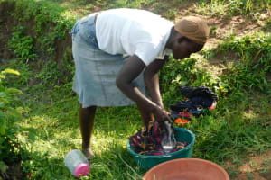 The Water Project: Ikoli Community, Odongo Spring -  Doing Some Laundry