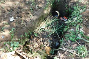 The Water Project: Ikoli Community, Odongo Spring -  Garbage Pit