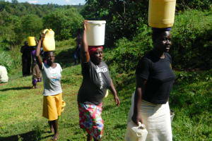 The Water Project: Ikoli Community, Odongo Spring -  Taking Water Home From Odongo Spring