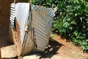 The Water Project: Mushikulu B Community, Olando Spring -  Bathing Shelter Outside