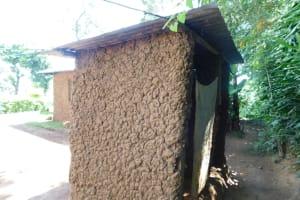 The Water Project: Mushikulu B Community, Olando Spring -  Latrine Outside