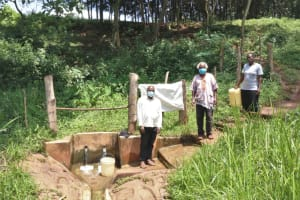 The Water Project: Irumbi Community, Okang'a Spring -  Pius Christopher And Mrs Okanga At The Spring