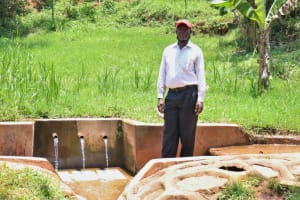 The Water Project: Irumbi Community, Shatsala Spring -  Isaac At The Spring