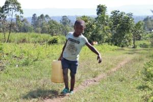 The Water Project: Bung'onye Community, Shilangu Spring -  Evans Walking Home From Shilangu Spring