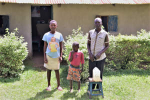 The Water Project: Bukhaywa Community, Shidero Spring -  Andrew With His Children In Front Of Their House