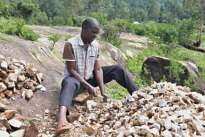 The Water Project: Bukhaywa Community, Shidero Spring -  We Found Sir Andrew Making Gravel