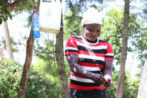The Water Project: Buyangu Community, Osundwa Spring -  Mercy Cleaning Her Hands