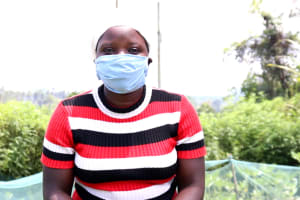 The Water Project: Buyangu Community, Osundwa Spring -  With Her Mask On
