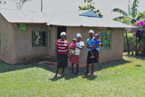 The Water Project: Buyangu Community, Osundwa Spring -  With Her Sisters Outside Their Home