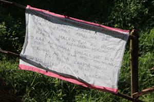 The Water Project: Mahira Community, Wora Spring -  Covid Prevention Reminder Chart