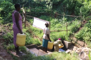 The Water Project: Mahira Community, Wora Spring -  Physical Distancing At The Spring