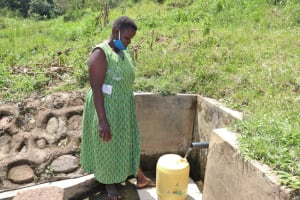 The Water Project: Shitoto Community, Abraham Spring -  At The Spring Fetching Water