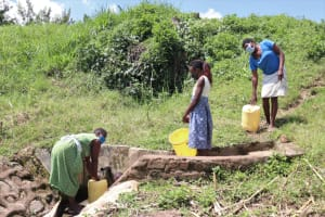 The Water Project: Shitoto Community, Abraham Spring -  Physical Distancing At The Spring