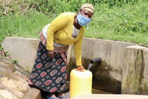 The Water Project: Handidi Community, Malezi Spring -  Leaving With Water From Malezi Spring