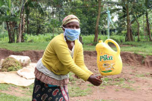 The Water Project: Handidi Community, Malezi Spring -  Washing Her Hands At Home