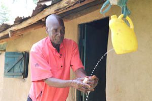 The Water Project: Handidi Community, Kadasia Spring -  Washing His Hands
