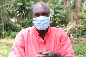 The Water Project: Handidi Community, Kadasia Spring -  With His Mask On