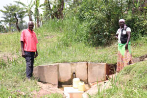 The Water Project: Handidi Community, Kadasia Spring -  Zacharaiah And His Wife At The Spring