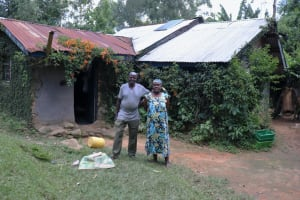 The Water Project: Shitoto Community, Laurence Spring -  Laurence And His Wife Outside Their Home