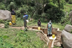 The Water Project: Shitoto Community, Laurence Spring -  Physical Distancing At The Spring