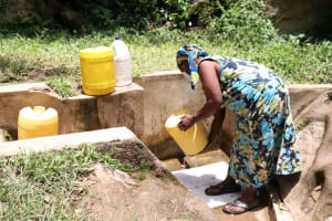 The Water Project: Shitoto Community, Laurence Spring -  Rinsing Her Container Before Fetching Water
