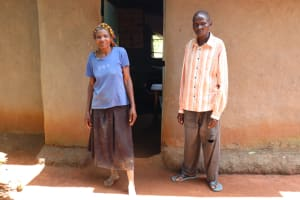 The Water Project: Luyeshe Community, Simwa Spring -  Loice With Her Husband In Front Of Their House