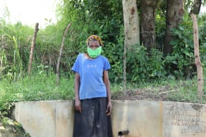 The Water Project: Luyeshe Community, Simwa Spring -  Mrs Simwa At The Waterpoint