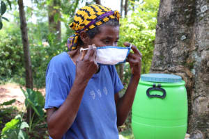 The Water Project: Luyeshe Community, Simwa Spring -  Putting On Her Mask