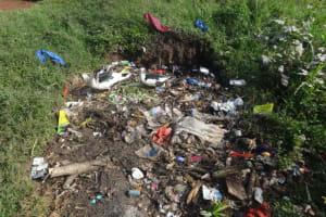 The Water Project: Isanjiro Community, Musambai Spring -  Garbage Disposal Area