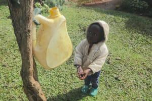 The Water Project: Isanjiro Community, Musambai Spring -  Kevin Washing His Hands
