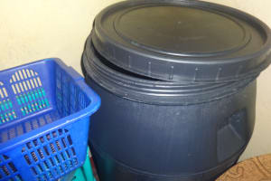 The Water Project: Isanjiro Community, Musambai Spring -  Plastic Water Storage Tank