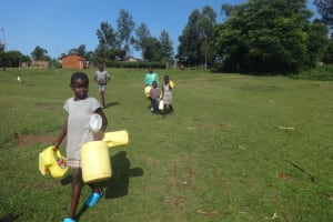 The Water Project: Isanjiro Community, Musambai Spring -  Heading To Fetch Water