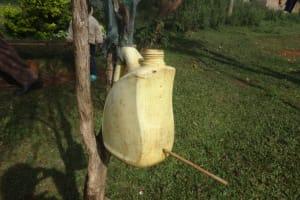 The Water Project: Isanjiro Community, Musambai Spring -  Leaky Tin Handwashing Point